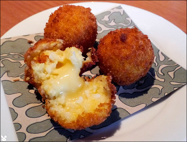 of polenta masquerading as arancini were filled with raclette which ...
